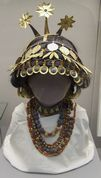Reconstructed sumerian necklaces and headgear discovered in the tomb of Queen Puabi. British Museum.